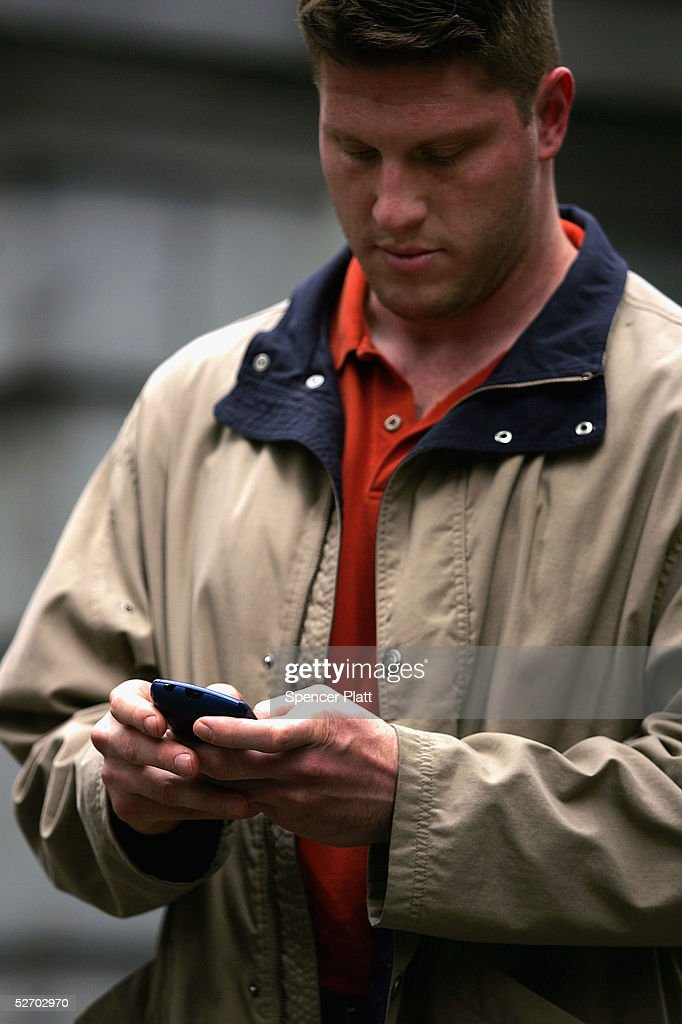 A man types on his Blackberry hand-held device April 27, 2005 in New York City. According to the American Society of Hand Therapists, hand held electronic devices, which have become increasingly popular in the U.S., are causing an increasing number of carpal tunnel syndrome and tendonitis cases.