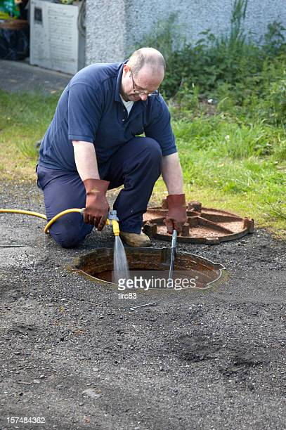 Man unblocking the drains