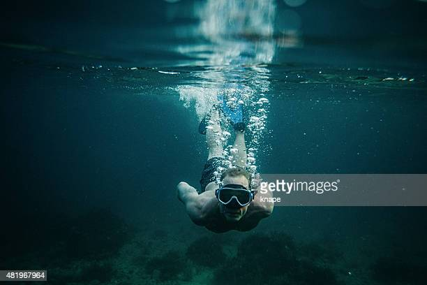 Man underwater in sea with scuba mask