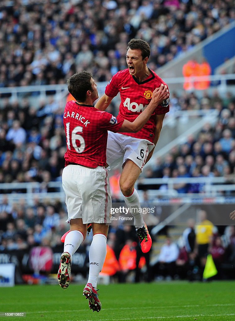 Man United player Jonny Evans (c) celebrates after scoring the first goal during the Barclays Premier league game between Newcastle United and Manchester United at Sports Direct Arena on October 7, 2012 in Newcastle upon Tyne, England.