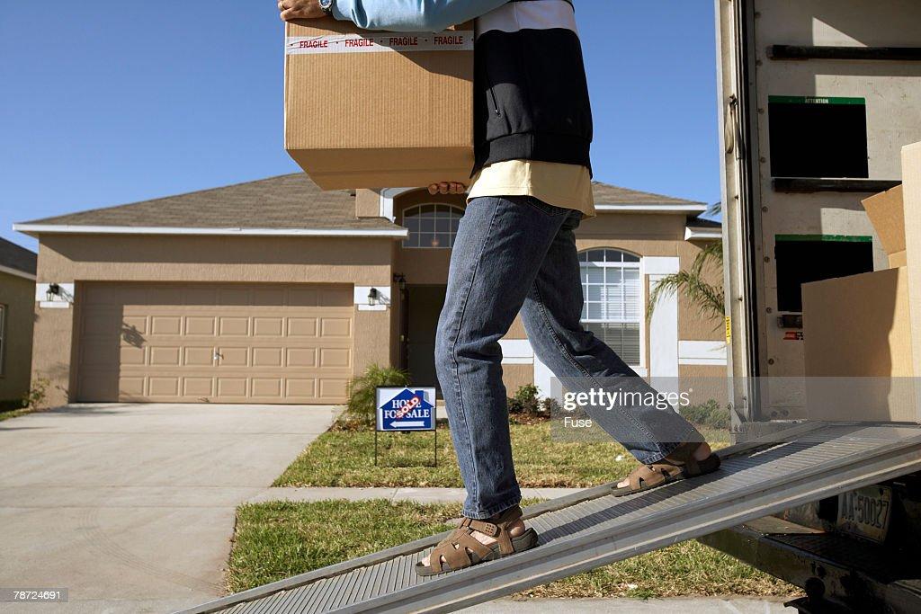 Man Unloading Box from Moving Van