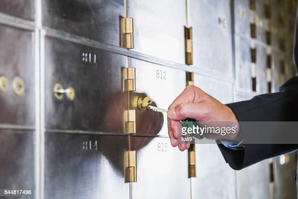 Man unlocking a safety deposit box