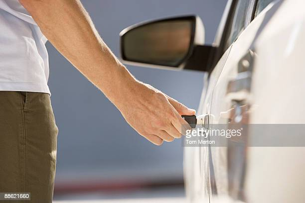 Man unlocking car door