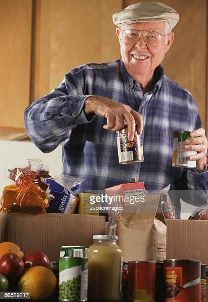 Man unpacking groceries