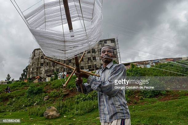 A man unrolls a skein of cotton thread near Shiro Meda market on July 10 2014 in Addis Ababa Ethiopia The Ethiopian government has recently launched...