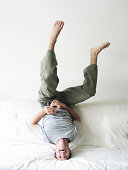Man upside down on the couch