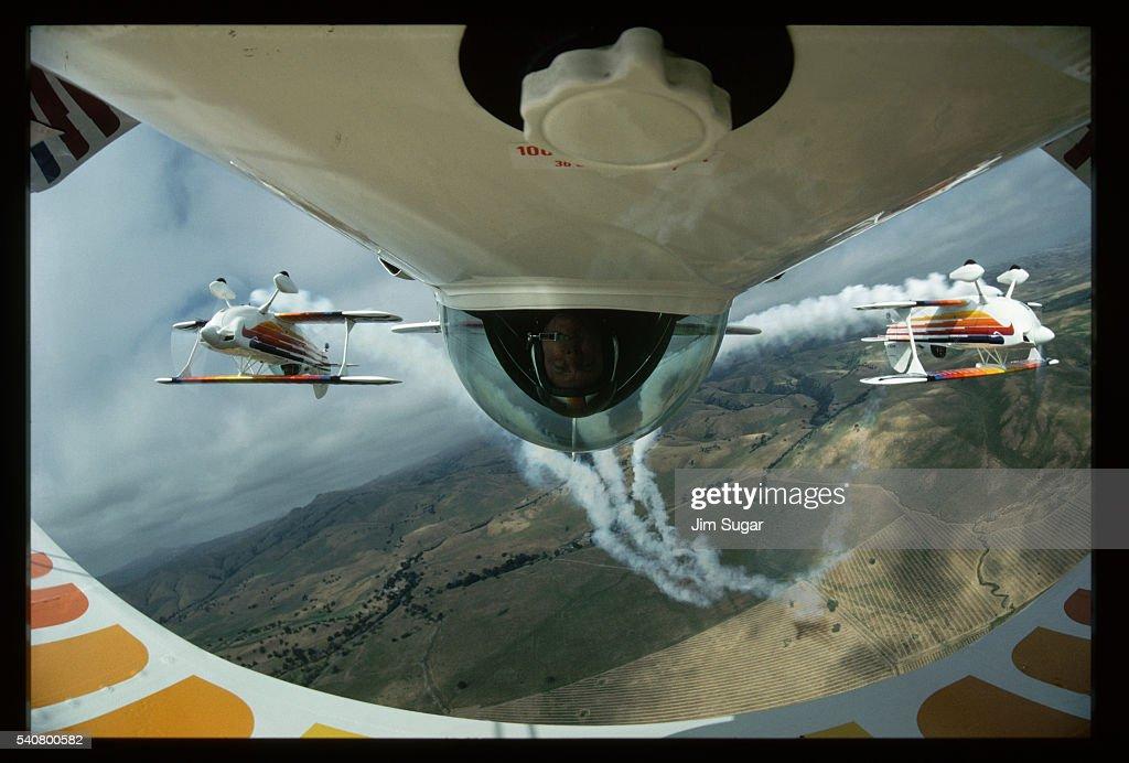 Man Upside-Down in Cockpit