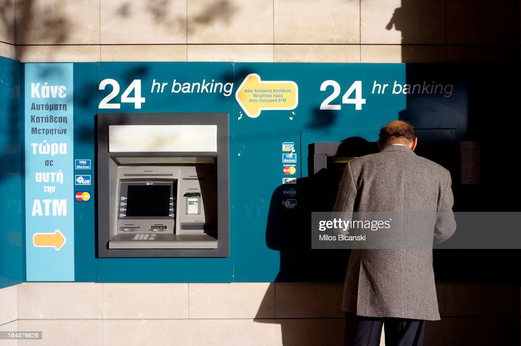 A man use an ATM machine at a bank on March 23, 2013 in Nicosia, Cyprus. The Cyprus government are seeking an agreement with Brussels to secure a 10 billion euro bailout to rescue the island's failing banks.