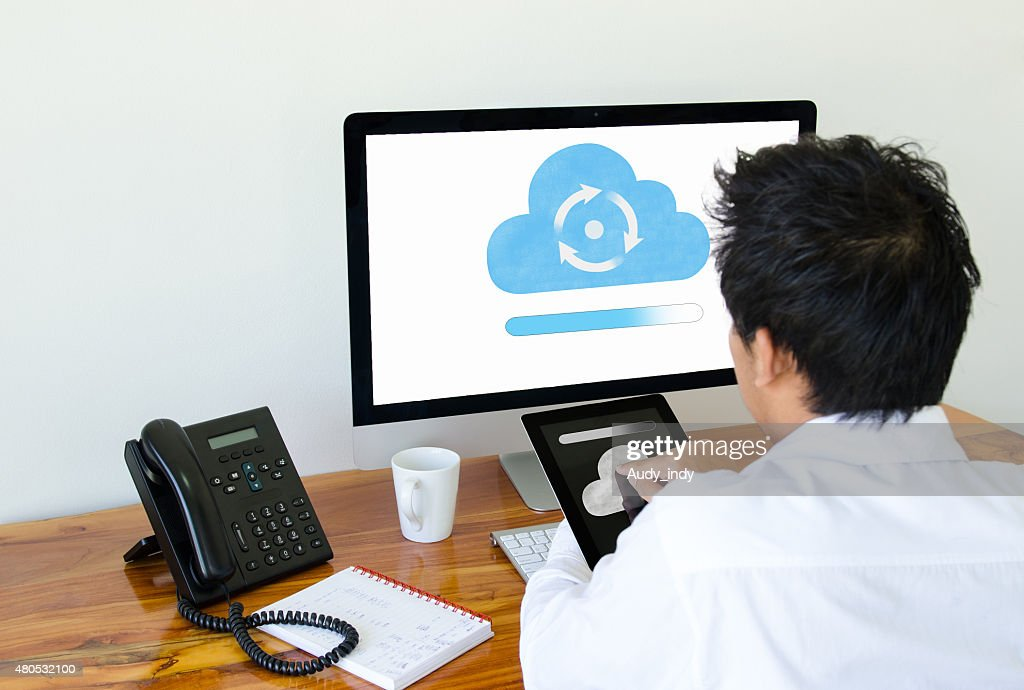 Man use cloud technology on tablet and computer : Stockfoto