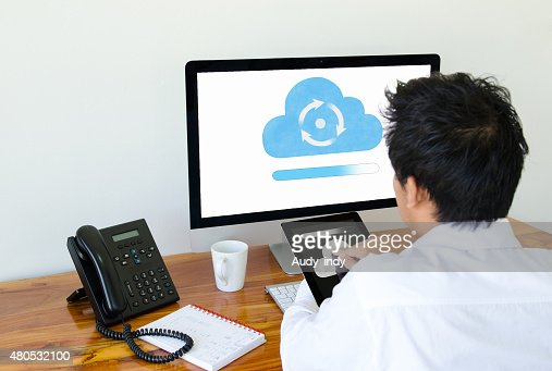 Man use cloud technology on tablet and computer : Stock Photo