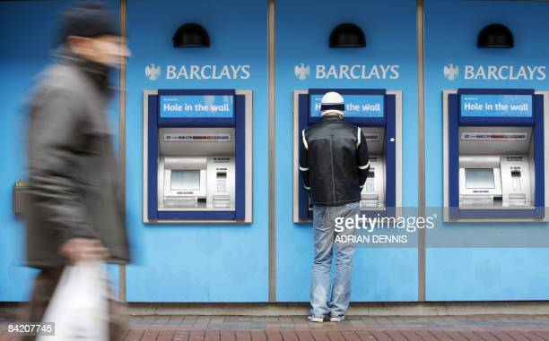 A man uses a cashpoint machine at a Barclays Bank branch in Hounslow west London on January 8 2009 The Bank of England on Thursday cut its key...