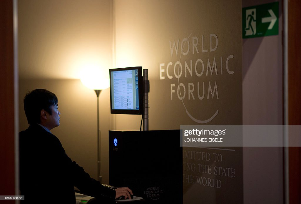 A man uses a computer on January 23, 2013 during the opening of the annual World Economic Forum meeting in the Swiss resort of Davos. The world's political and business elite gathered on January 23 in Davos, aiming to instill some confidence in the global economy amid tentative signs of recovery.