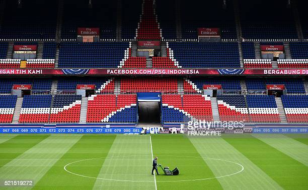 A man uses a lawn mower at Parc des Princes stadium in Paris on April 15 2016 Built in 1972 Parc des Princes can hold over 48000 spectators and will...