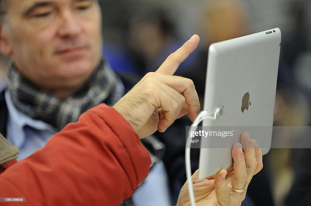 A man uses a new iPad mini during the opening of a new Apple store on November 15, 2012 in Saint-Herblain, western France.