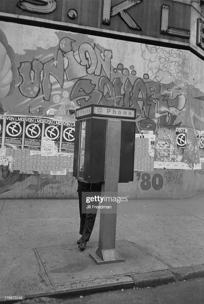 A man uses a public pay phone in Union Square, New York City, 1981.