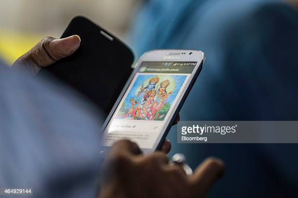 A man uses a Samsung Electronics Co smartphone in Mumbai India on Saturday Feb 28 2015 The government auction of telecom wireless spectrum starting...