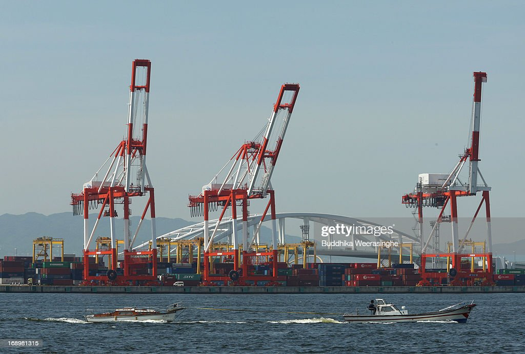A man uses a small boat to transports goods beside the containers terminal at Port Island on May 17, 2013 in Osaka, Japan. Japan's economy recently shows the sign of recovery as the growth of last quarter was 0.9 percent, or 3.5 percent on annual basis.