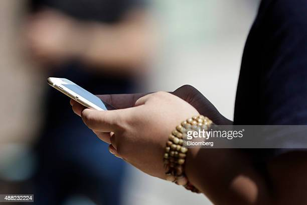 A man uses a smartphone in Tokyo Japan on Monday Sept 14 2015 NTT Docomo Inc led declines among Japanese wireless carriers plunging the most in...