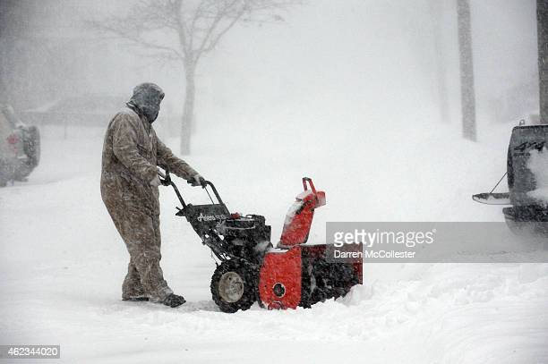 A man uses a snowblower to remove snow from his driveway on Pearl Street January 27 2015 in Winthrop Massachusetts An overnight blizzard hit the...