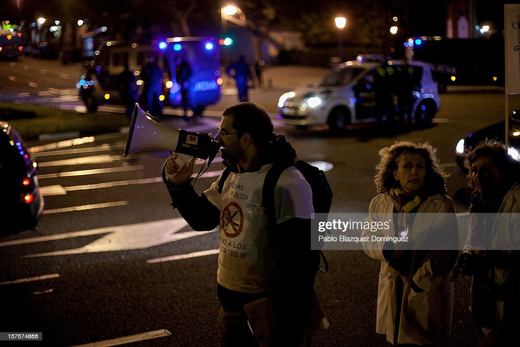 A man uses a speaker during a demonstration at Puente de Toledo on December 4, 2012 in Madrid, Spain. All trade unions called for the second 48 hours health workers' general strike in Madrid region, after Regional Government announced severe cuts and privatization of Medical Centers.