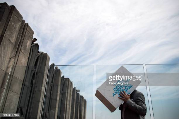 A man uses a viewing box during the solar eclipse at 'Top of the Rock' observatory at Rockefeller Center August 21 2017 in New York City While New...