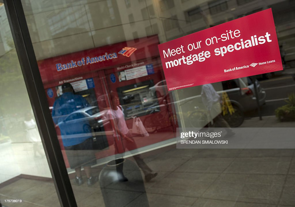 A man uses an ATM as a sticker advertises mortgages at a Bank of America August 7 2013 in Washington DC The United States government has filed two...