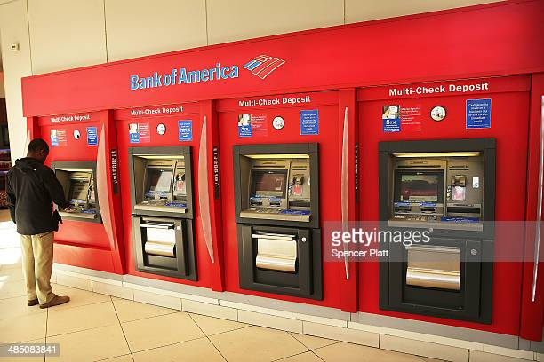 A man uses an ATM at a Bank of America branch on April 16 2014 in New York City As the nation's secondlargest bank continues to struggle with fallout...