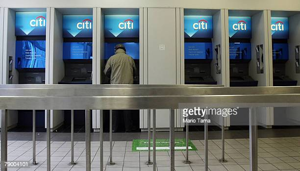A man uses an ATM in a Citibank branch January 15 2008 in New York City Citigroup posted a $983 billion loss related to subprime lending and is...