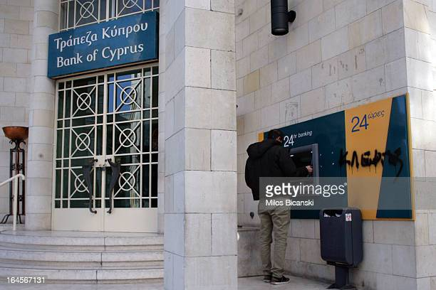 A man uses an ATM machine of the Bank Of Cyprus on March 24 2013 in Limassol Cyprus Talks between the the International Monetary Fund and European...