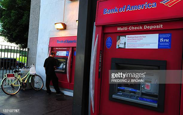 A man uses an automated teller machine in front of a branch of Bank of America in Hollywood California on August 23 2011 Disappointment that Bank of...