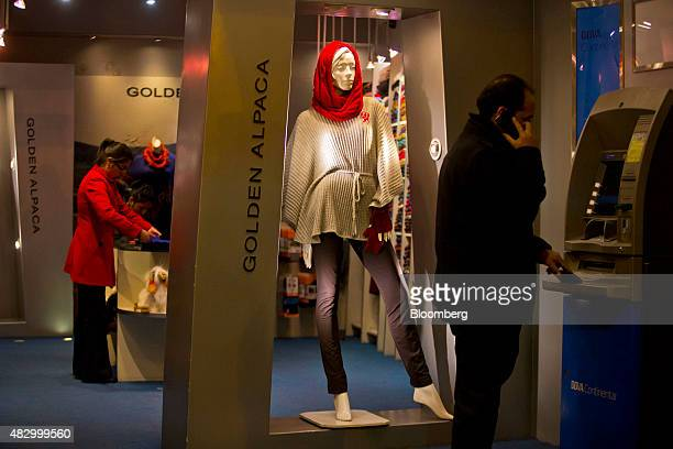 A man uses an automated teller machine inside an alpaca wool clothing store in Cuzco Peru on Thursday July 30 2015 Once the center of the Incan...