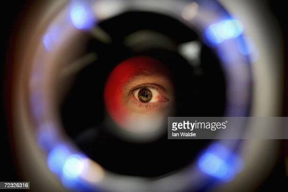 A man uses an iris recognition scanner during the Biometrics 2004 exhibition and conference October 14 2004 in London The conference will examine the...
