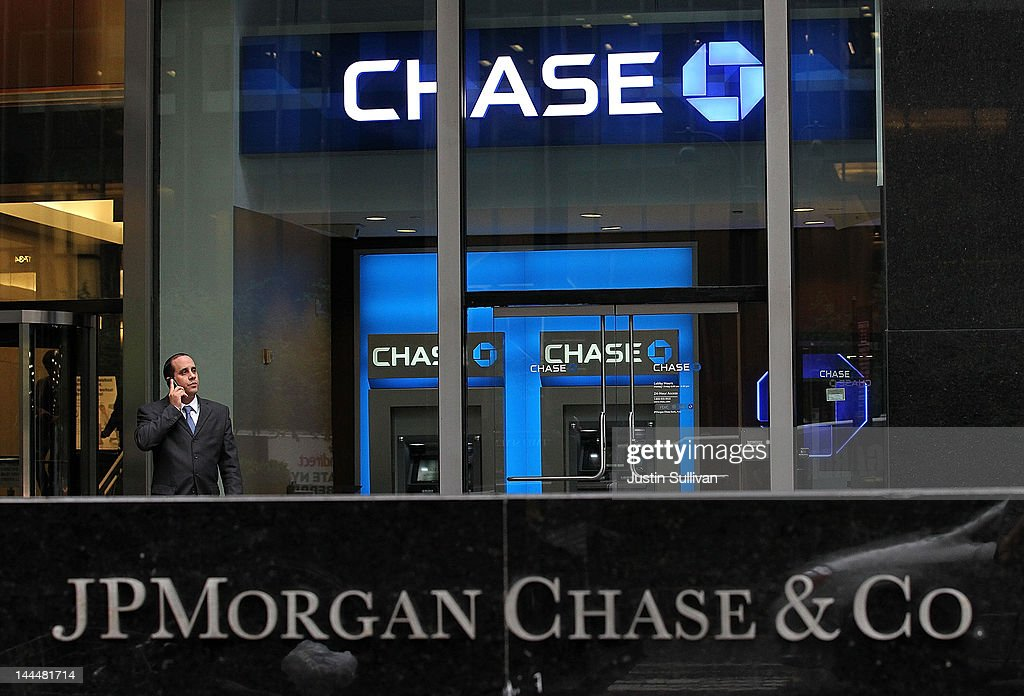 A man uses his cell phone by a sign outside of the JPMorgan Chase headquarters on May 14, 2012 in New York City. Following a $2 billion trading blunder, JPMorgan Chase's chief investment officer Ina Drew retired and will be succeeded by Matt Zames, an executive from JPMorgan's investment bank. At least two others are also being held accountable for the mistake.
