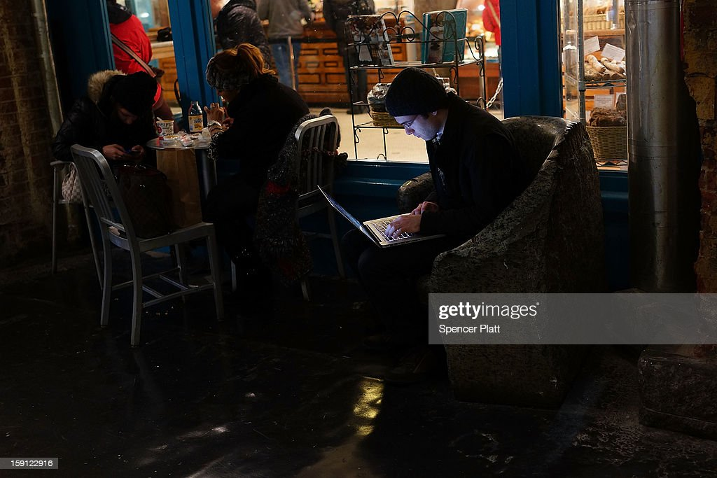 A man uses his laptop in the Chelsea Markets after a news conference where it was announced that free Wi-Fi will be provided to the Manhattan neighborhood of Chelsea on January 8, 2013 in New York City. Google has teamed up with the Chelsea Improvement Project, a local New York City non-profit and the city government to provide free Wi-Fi to the historic neighborhood. The network will become the largest public outdoor service of its kind in New York, and the first neighborhood in the city with free WiFi.