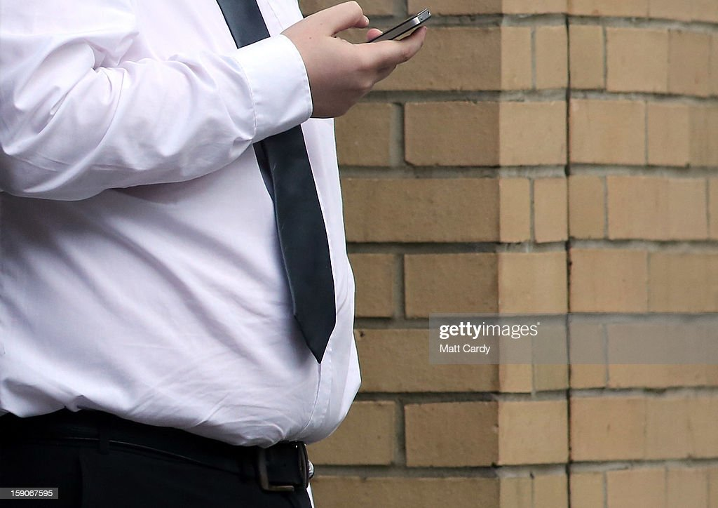 A man uses his mobile phone on January 7, 2013 in Bristol, England. A government-backed TV advert - made by Aardman, the creators of Wallace and Gromit - to promote healthy eating in England, is to be shown for the first time later today. England has one of the highest rates of obesity in Europe - costing the NHS 5 billion GDP each year - with currently over 60 percent of adults and a third of 10 and 11 year olds thought to be overweight or obese.