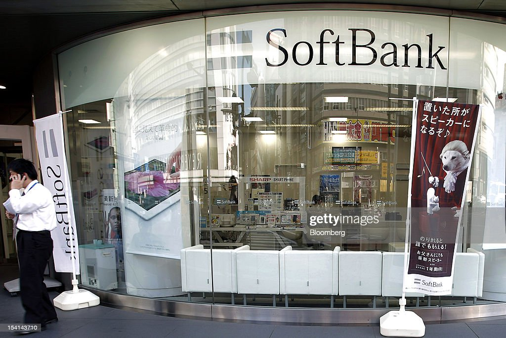 A man uses his mobile phone outside a Softbank Corp. store in Tokyo, Japan, on Monday, Oct. 15, 2012. Softbank agreed to pay $20.1 billion to acquire about a 70 percent stake in Sprint Nextel Corp. as Japan's third-biggest mobile-phone operator seeks growth overseas amid a declining local market. Photographer: Kiyoshi Ota/Bloomberg via Getty Images