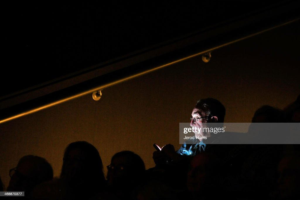 A man uses his smart phone following a special screening of 'Philomena' and conversation with Philomena Lee at the Museum Of Tolerance on February 11, 2014 in Los Angeles, California.