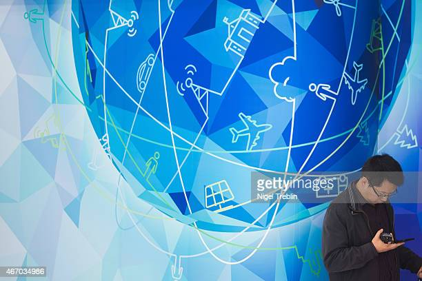 A man uses his smartphone at the Huawei stand at the 2015 CeBIT technology trade fair on March 20 2015 in Hanover Germany China is this year's CeBIT...