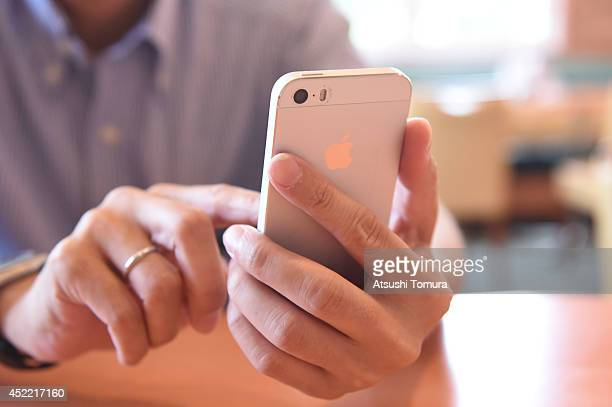 A man uses his smartphone on July 16 2014 in Tokyo Japan Only 535% of Japanese owned smartphones in March according to a white paper released by the...