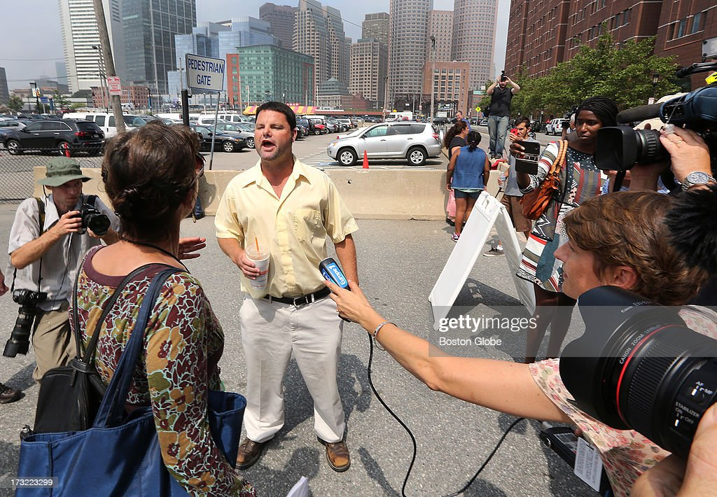 A man uses salty language for those who believe in Tsarnaev's innocence. Media and supporters of alleged Boston Marathon bombing suspect Dzhokhar Tsarnaev gather outside the John Joseph Moakley United States Courthouse, July 10, 2013, before the 19-year-old is charged.