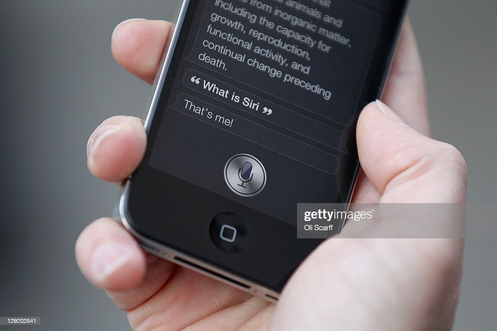 A man uses 'Siri' on the new iPhone 4S after being one of the first customers in the Apple store in Covent Garden on October 14, 2011 in London, England. The widely anticipated new mobile phone from Apple has seen customers queue in cities around the world for hours to be amongst the first to buy the device.