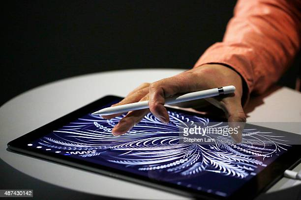 A man uses the new Apple Pencil on an iPad Pro after an Apple special event at Bill Graham Civic Auditorium September 9 2015 in San Francisco...
