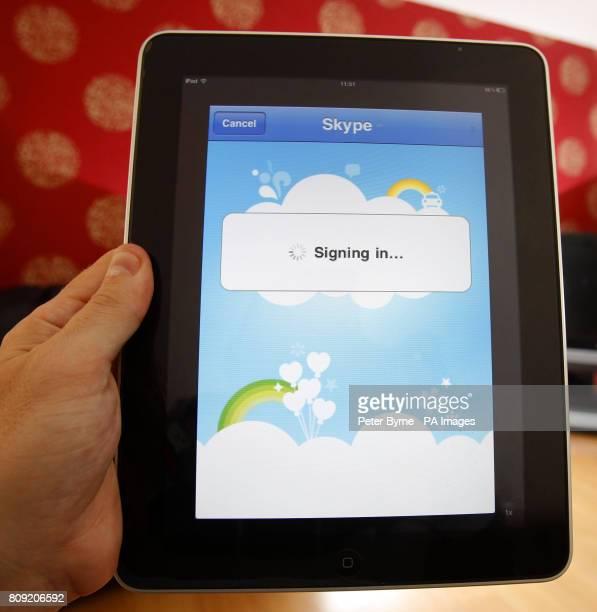 A man uses the Skype application on an iPad