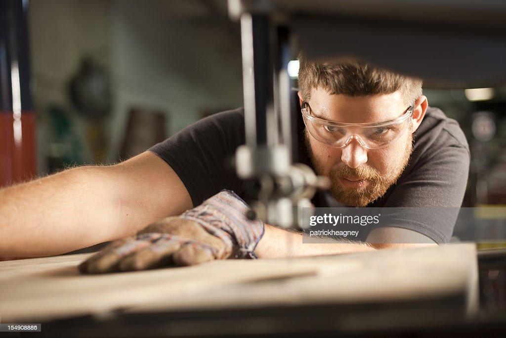 Man Using a Bandsaw