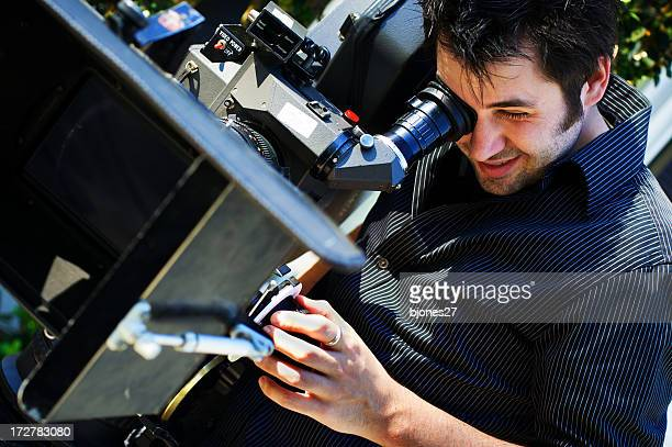 Man using a black video camera
