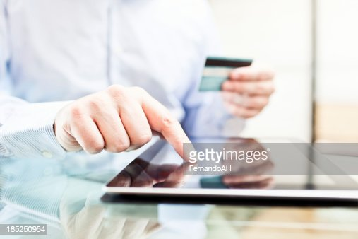 Man using a digital tablet for online buying