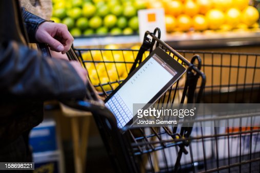 A man using a digital Tablet for shopping. : Stock Photo