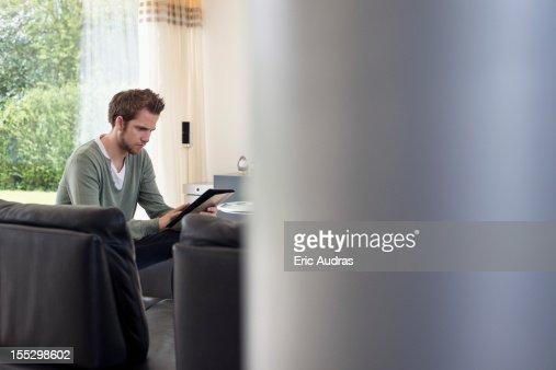 Man using a digital tablet : Stock Photo