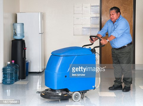 Man using a floor polishing machine in an office