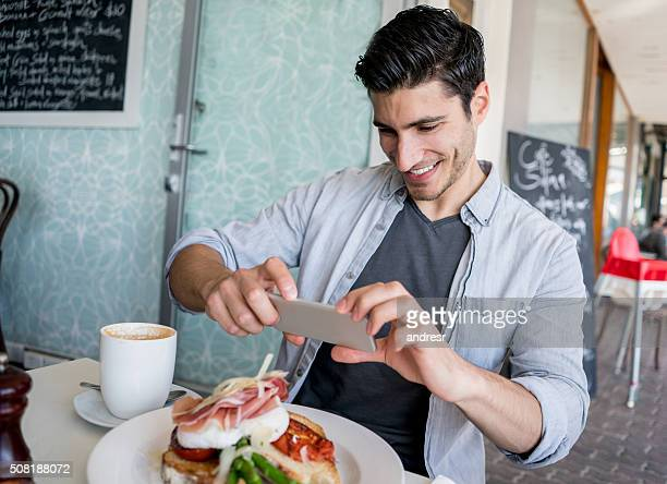 Man using a food app at a restaurant